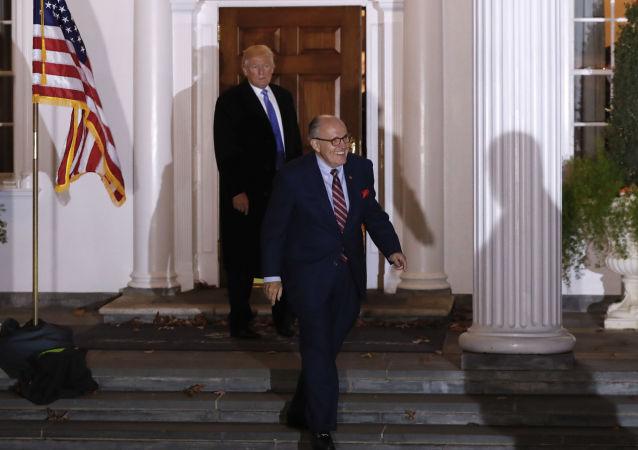 Rudy Giuliani walks to his motorcade vehicle