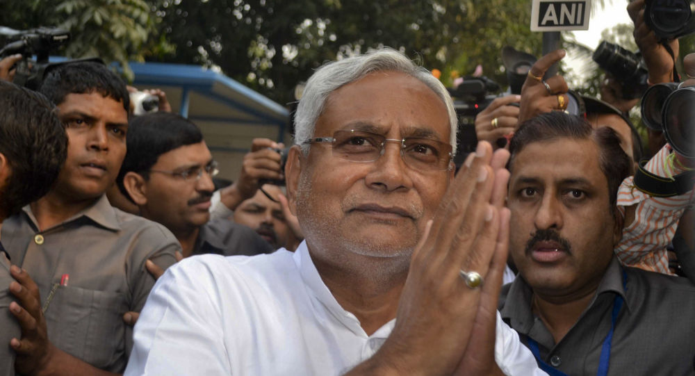 Bihar Chief Minister Nitish Kumar greets supporters after victory in Bihar state elections in Patna, India, Sunday, Nov. 8, 2015