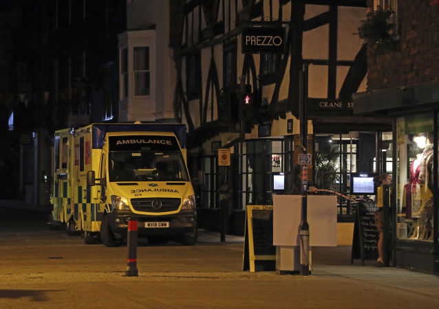 Ambulances are parked outside the Prezzo restaurant in Salisbury, Britain, where police closed roads as a precautionary measure after two people were taken ill from the restaurant, Sunday Sept. 16, 2018.