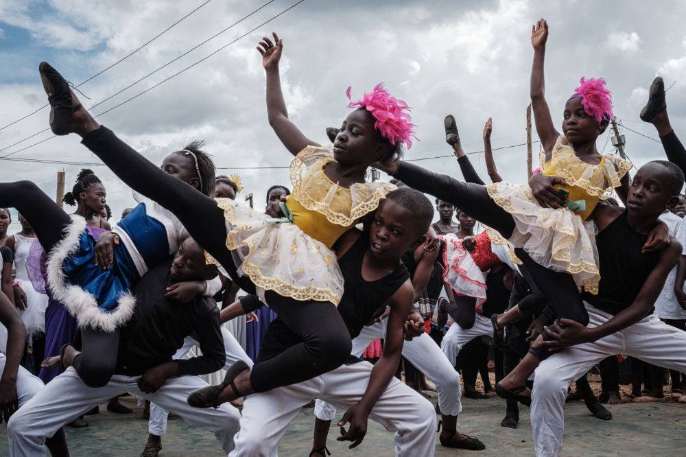Members of 'Project Elimu' perform during their presentation in Kibera, a slum in Nairobi, Kenya, on 14 December 2019. Project Elimu is a Kenyan NGP founded by Kenyan former professional dancer Mike Wamaya to provide a wide range of extracurricular activities to schools in informal settlements to empower children and teachers as over 400 children from 25 different schools participate.