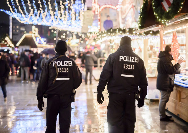 Police patrols at the reopened Christmas market near the Kaiser Wilhelm Memorial Church in Berlin on December 22, 2016