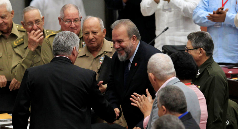 Cuban President Miguel Diaz-Canel and Tourism Minister Manuel Marrero Cruz, named as the country's first prime minister, a role created by the new constitution, shake hands during the ordinary session of the National Assembly in Havana, Cuba, December 21, 2019