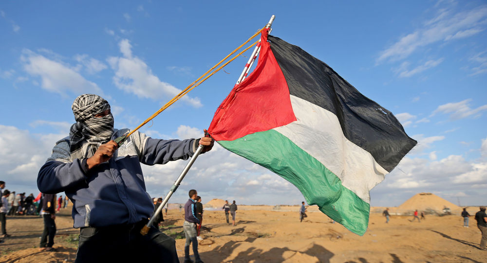 A Palestinian demonstrator uses a sling during an anti-Israel protest at the Israel-Gaza border fence, in the southern Gaza Strip December 6, 2019.