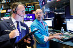 Traders work on the floor at the New York Stock Exchange (NYSE) in New York, U.S., December 17, 2019