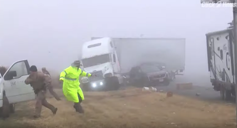 Video: Dramatic Footage Shows US State Troopers Barely Dodge Barreling Semi-Truck