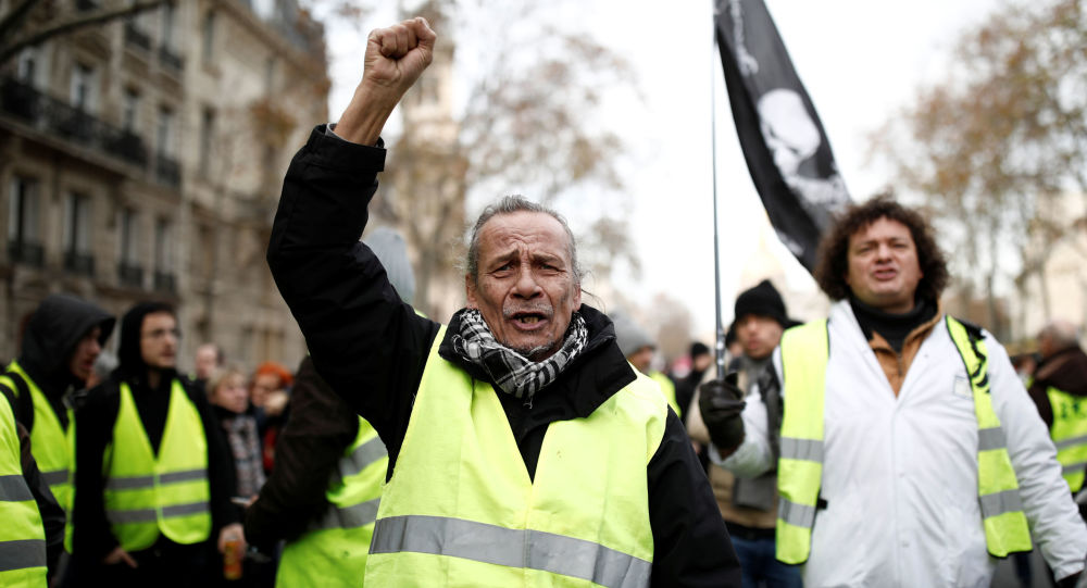 Protestors wearing yellow vests attend a demonstration against French government's pensions reform plans in Paris as part of a second day of national strike and protests in France, December 10, 2019.