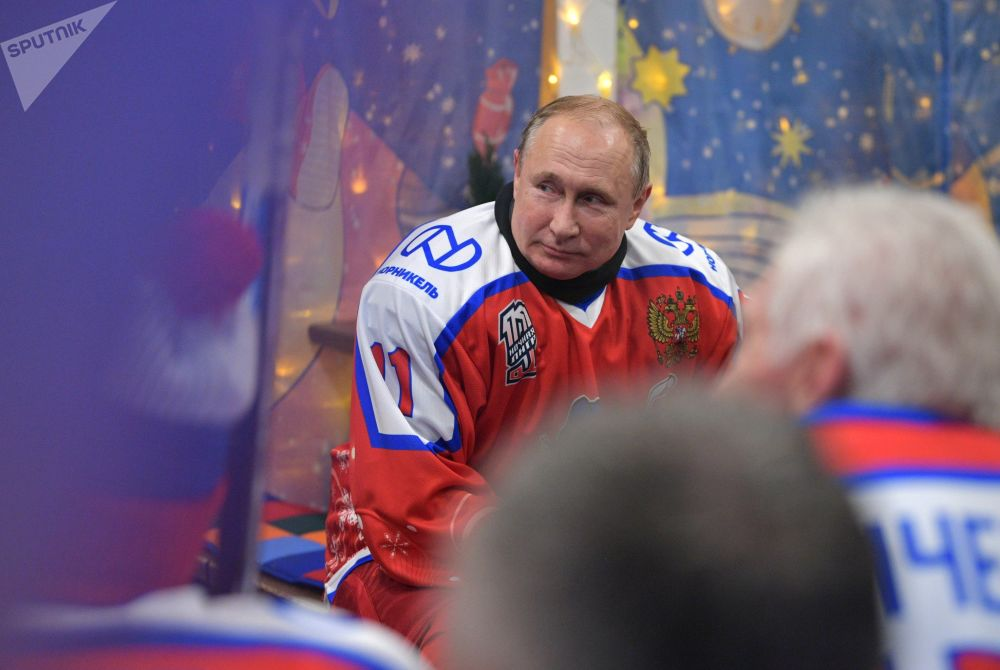 Russian President Vladimir Putin during a break at the New Year's friendly match of the Night Hockey League at the rink on Red Square.