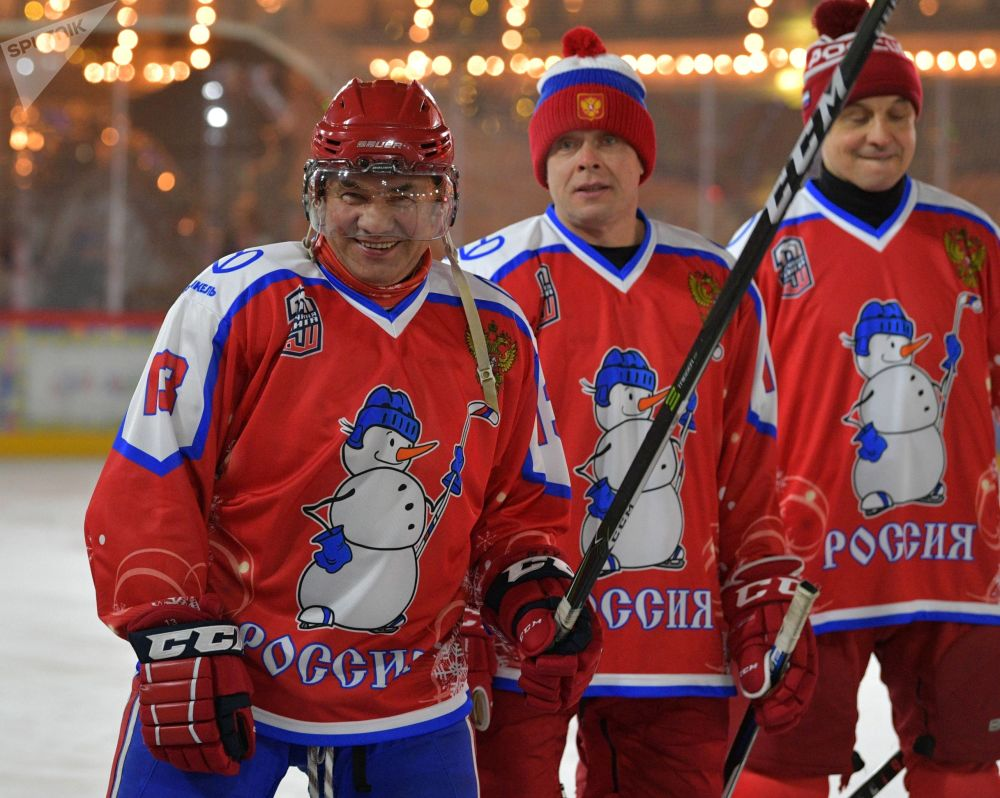 Russian Defence Minister Sergei Shoigu and President of the International League of World Hockey Legends Pavel Bure (left to right) before the start of the New Year's friendly Night Hockey League match at the ice rink on Red Square.
