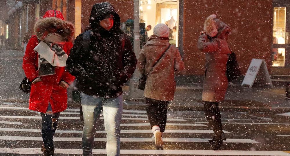 People walk during snow squalls in New York City