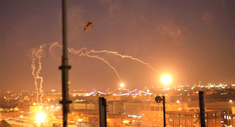 U.S. Army AH-64 Apache helicopters from 1st Battalion, 227th Aviation Regiment, 34th Combat Aviation Brigade, launch flares as they conduct overflights of the U.S. Embassy in Baghdad