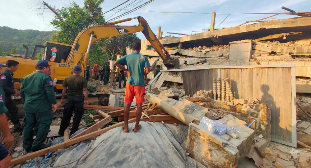 Photo provided by the Kep Province Authority Police, heavy machinery removes debris after a building collapsed in Kep province, Cambodia, Friday, Jan. 3, 2020.  At least two construction workers were killed when a seven-floor building collapsed in the southern Cambodian town of Kep on Friday, according to the police.