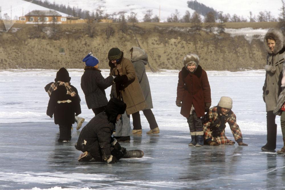 Children play on frozen Lake Baikal in 1988