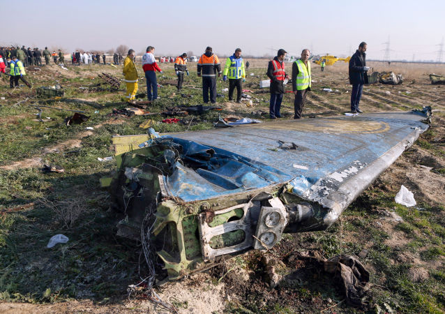 Rescue teams are seen on January 8, 2020 at the scene of a Ukrainian airliner that crashed shortly after take-off near Imam Khomeini airport in the Iranian capital Tehran