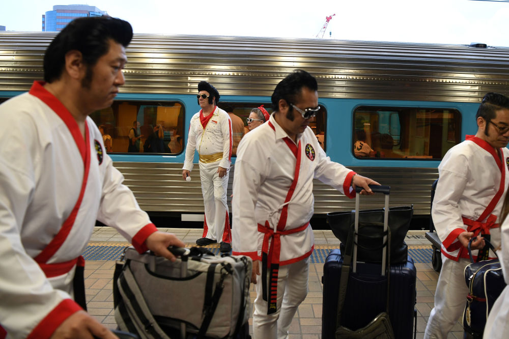 Elvis impersonators prepare to board the Elvis Express, bound for Parkes for the Elvis festival, at Central Station in Sydney, Australia, 9 January 2020.