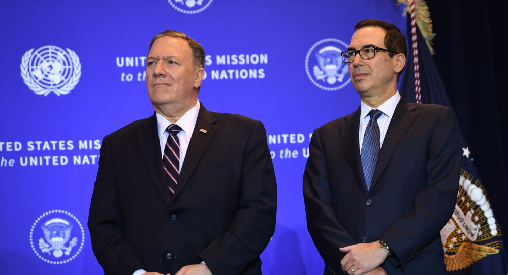US Secretary of State Mike Pompeo and Secretary of the Treasury Steven Mnuchin listen as President Donald Trump speaks at a press conference in New York, September 25, 2019, on the sidelines of the United Nations General Assembly.