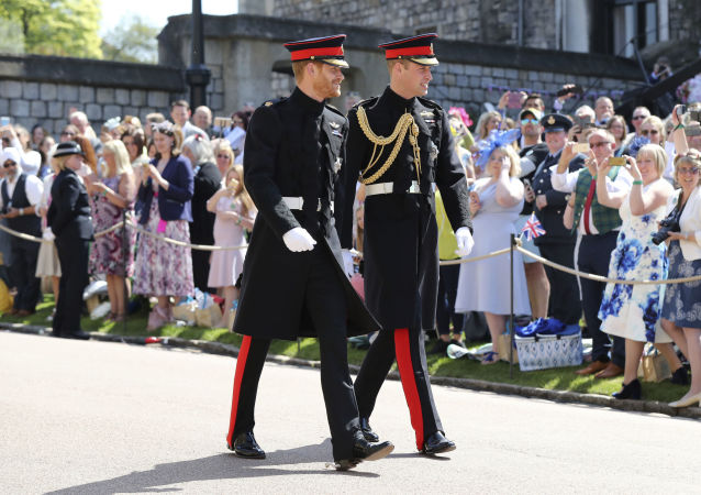 Britain's Prince Harry, left, and best man Prince William arrive for the wedding ceremony at St. George's Chapel in Windsor Castle in Windsor, near London, England, Saturday, May 19, 2018