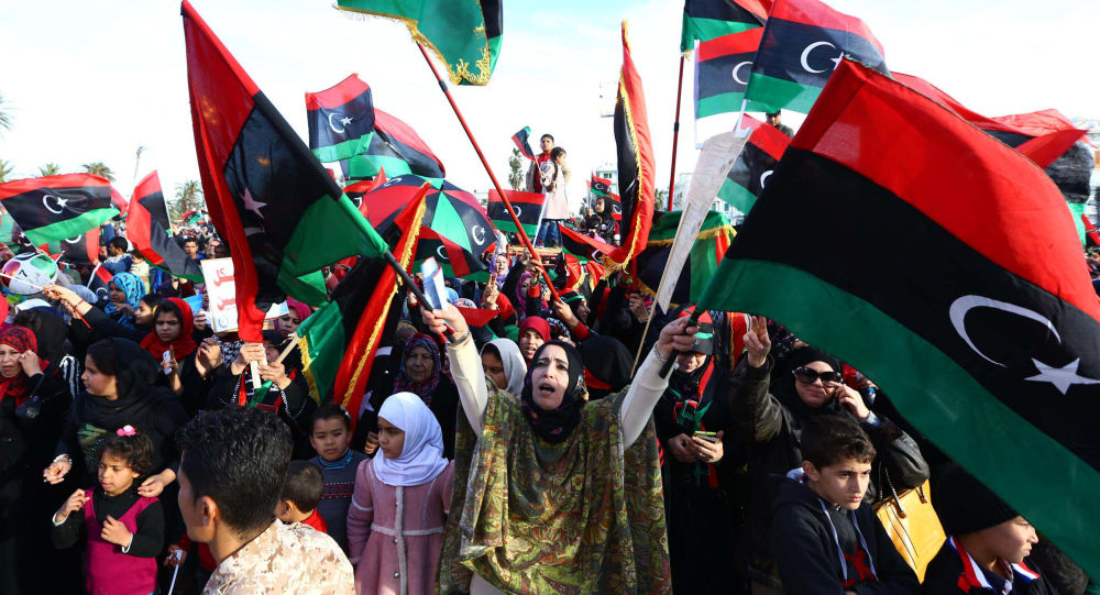 Libyans celebrate in Tripoli's landamark Martyrs square on February 17, 2015 the upcoming fourth anniversary of the Libyan revolution