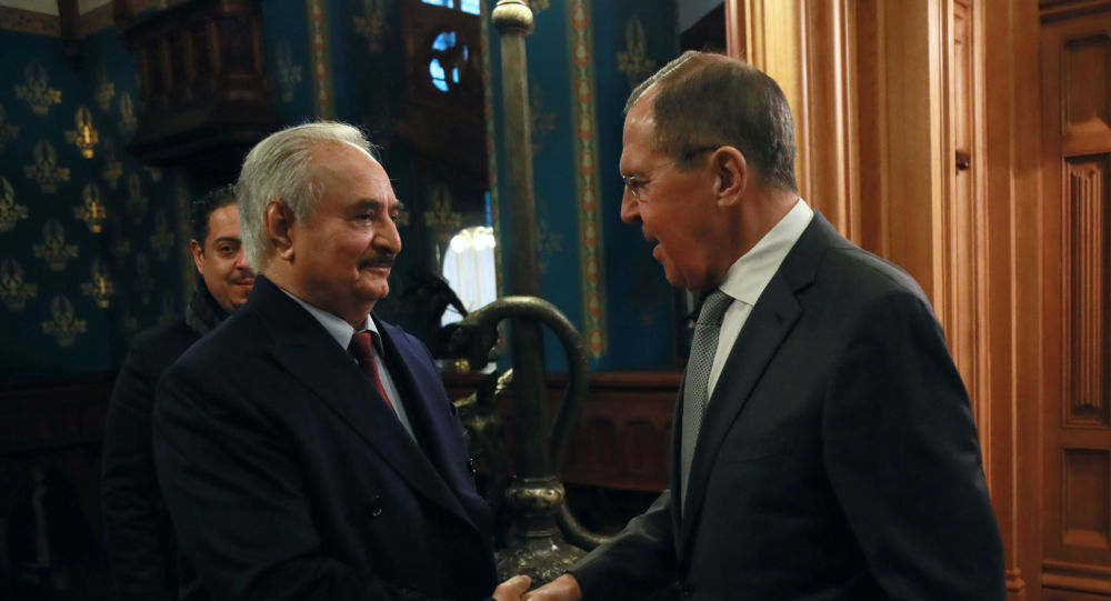This handout picture released by the Russian Foreign Ministry on January 13, 2020 shows Russian Foreign Minister Sergei Lavrov welcoming Libya's military strongman Khalifa Haftar in Moscow.
