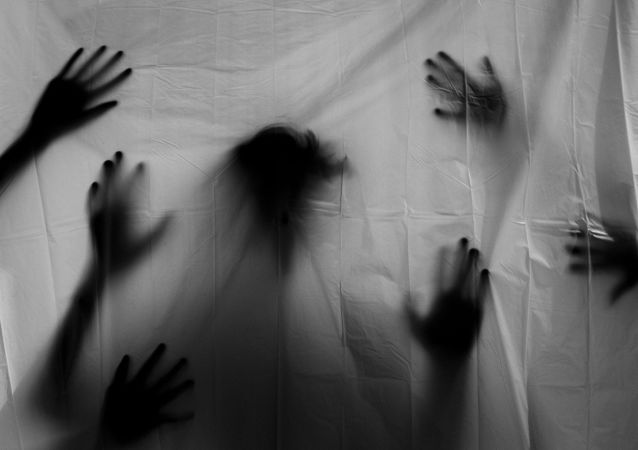 Shadows of female hands