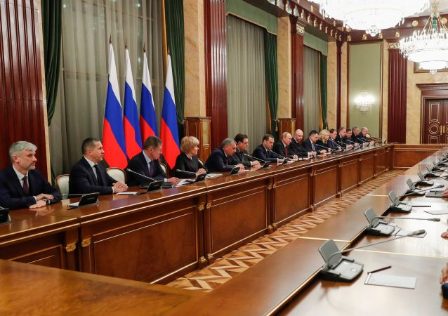 Russian President Vladimir Putin and Russian Prime Minister Dmitry Medvedev attend a meeting with the Russian government members