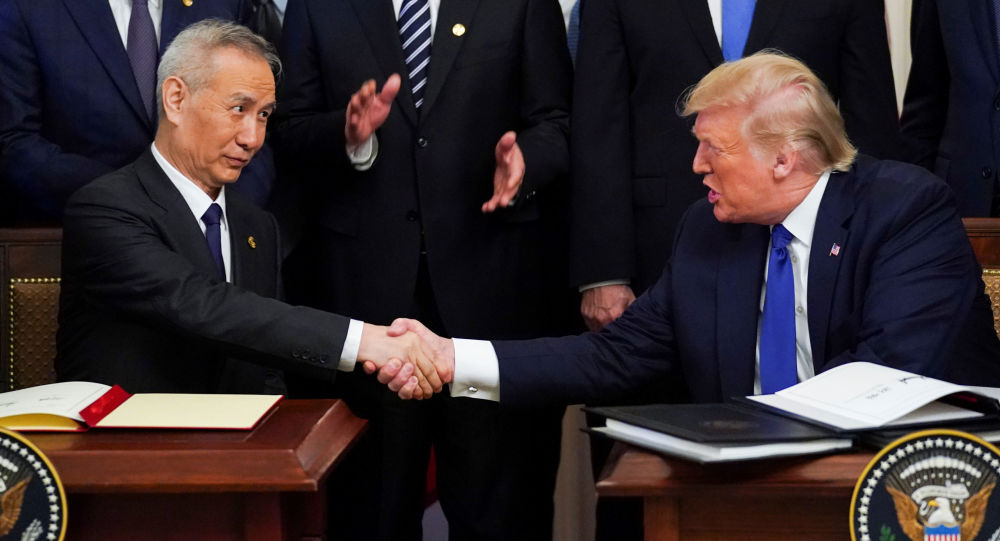 Chinese Vice Premier Liu He and U.S. President Donald Trump shake hands after signing phase one of the U.S.-China trade agreement