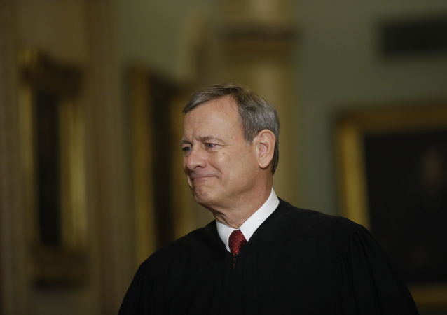 Chief Justice of the United States, John Roberts walks to the Senate chamber at the Capitol in Washington, Thursday, Jan. 16, 2020
