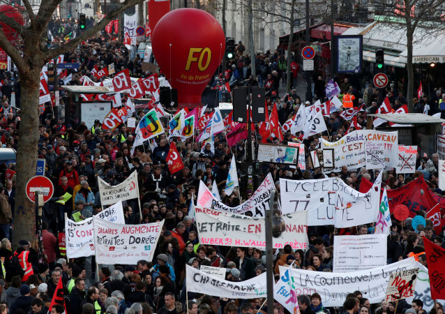 French Labour Unions and Workers on Strike Against Pensions Reforms in Paris
