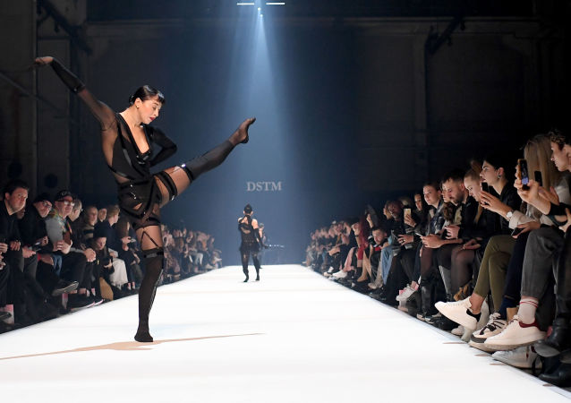 Dancers present creations of the label Dont Shoot The Messengers (DSTM) during a fashion show at the Berlin Fashion Week on January 15, 2020 in Berlin.