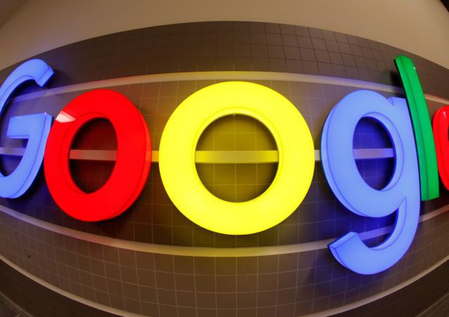 An illuminated Google logo inside an office building in Zurich, Switzerland, December 5, 2018