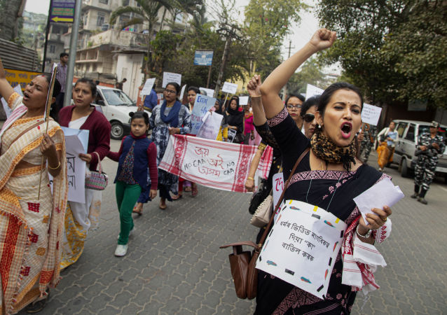 Indian women participate in a protest procession against the Citizenship Amendment Act in Gauhati, India, Sunday, Jan. 19, 2020