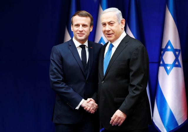Israeli Prime Minister Benjamin Netanyahu and French President Emmanuel Macron shake hands during their meeting in Jerusalem January 22, 2020