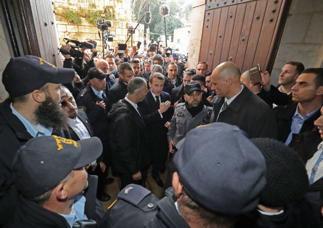 French President Emmanuel Macron asks Israeli police officers to leave the French 12th-century Church of Saint Anne in the old city of Jerusalem on January 22, 2020