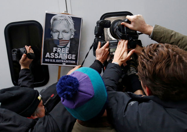Photographers take pictures of WikiLeaks' founder Julian Assange as he leaves Westminster Magistrates Court in London, Britain January 13, 2020