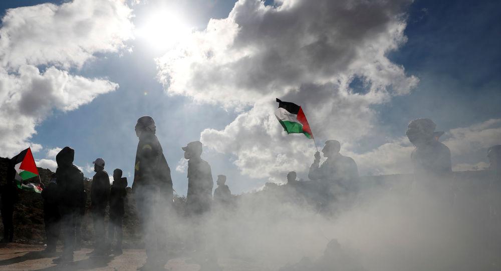 Palestinian demonstrators take part in an anti-Israel protest in al-Mughayyir village near Ramallah, in the Israeli-occupied West Bank, January 3, 2020.