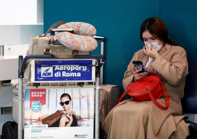 A passenger in a protective mask is seen at Rome's Fiumicino airport, after first cases of coronavirus were confirmed in Italy, January 31, 2020