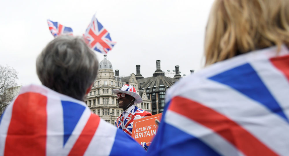 A pro-Brexit supporter holds a placard at Parliament Square on Brexit day