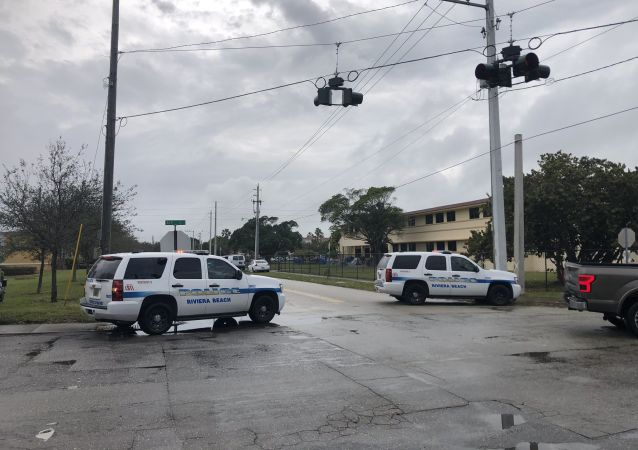 "Riviera Beach Fire Rescue responding to ""multiple people"" shot. Multiple police vehicles with lights flashing just west of Avenue E/W 20th Street"