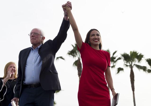 Democratic presidential candidate Sen. Bernie Sanders, I-Vt., and Rep. Alexandria Ocasio-Cortez, D-N.Y.