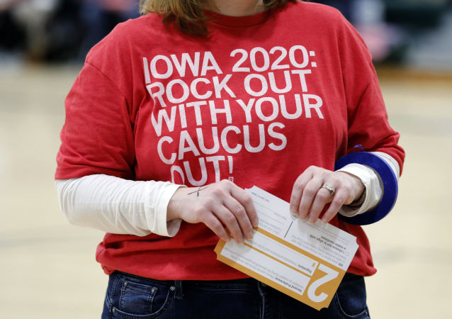 A local resident holds a Presidential Preference Card during an Iowa Democratic caucus at Hoover High School, Monday, Feb. 3, 2020, in Des Moines, Iowa.