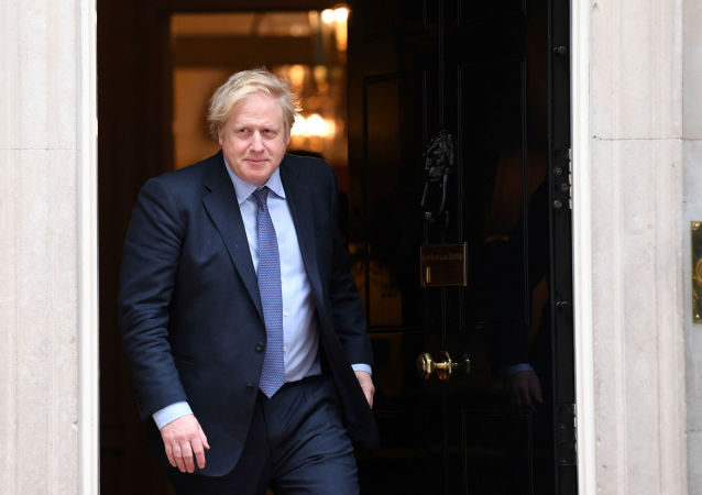 Britain's Prime Minister Boris Johnson goes out to welcome the Sultan of Brunei, Hassanal Bolkiah (not pictured), at Downing Street in London, Britain, February 4, 2020. Stefan Rousseau/Pool via REUTERS
