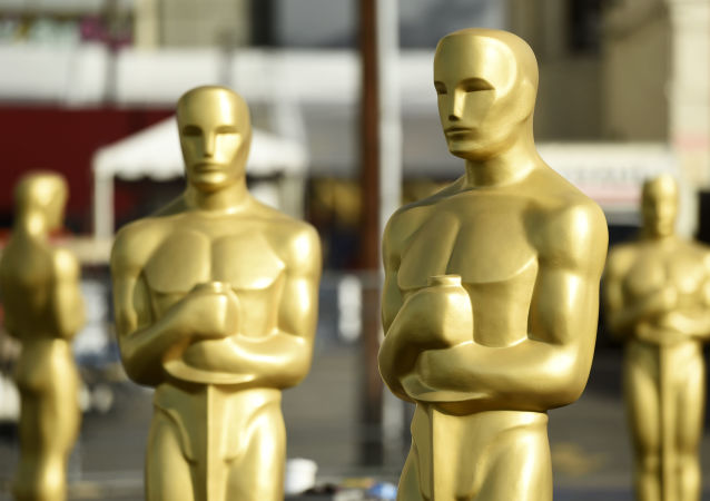 Oscar statues stand off of Hollywood Boulevard in preparation for Sunday's 92nd Academy Awards at the Dolby Theatre, Wednesday, Feb. 5, 2020, in Los Angeles