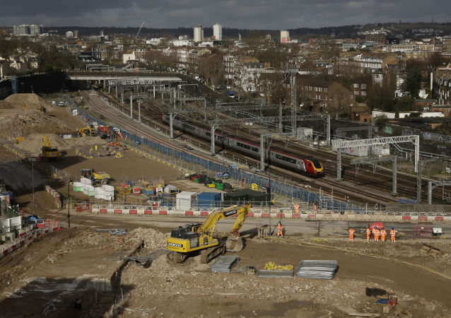 A train passes the construction site of the High Speed 2 (HS2) rail line at Euston station in London