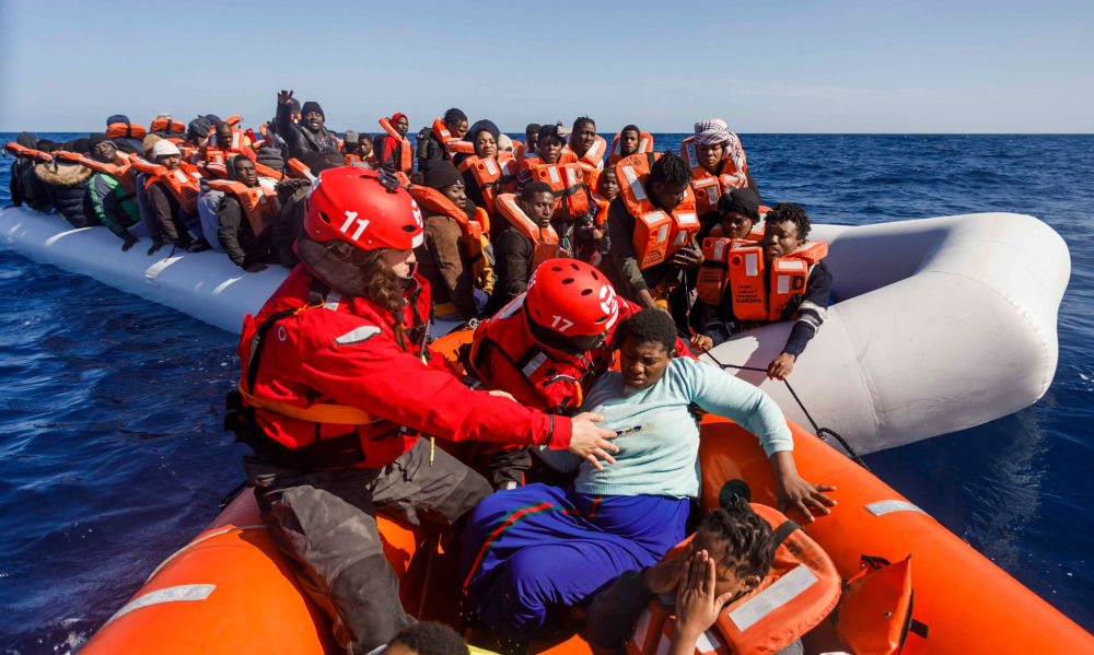 Members of the Spanish NGO Maydayterraneo prepare to sail back to the Aita Mari rescue boat after rescuing about 90 migrants in the Mediterranean open sea off the Libyan coast on February 9, 2020.