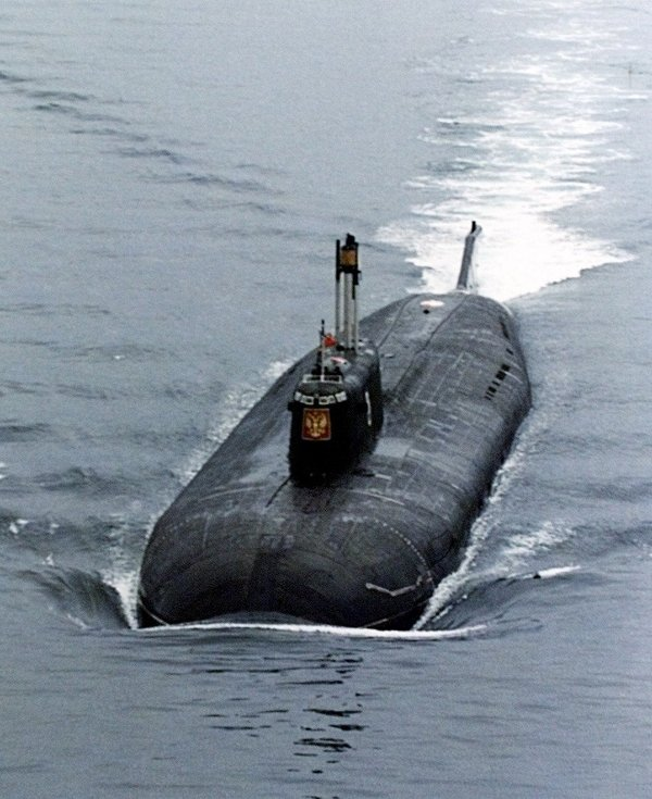 The Kursk, one of Russia's largest and most advanced submarines, which exploded and sank during naval maneuvers in August 2000, heaves ahead in the Barents Sea near Severomorsk in this 1999 file photo.